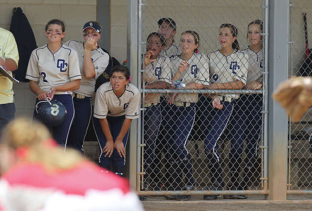The O'Connor dugout cheers on a teammate at bat against Judson in the second round of Class 5A softball playoffs on Saturday, May 5, 2012. O'Connor took the series by winning the first game on Friday and then again on Saturday with a 10-3 win over Judson. Photo: KIN MAN HUI, Kin Man Hui/Express-News / ©2012 San Antonio Express-News