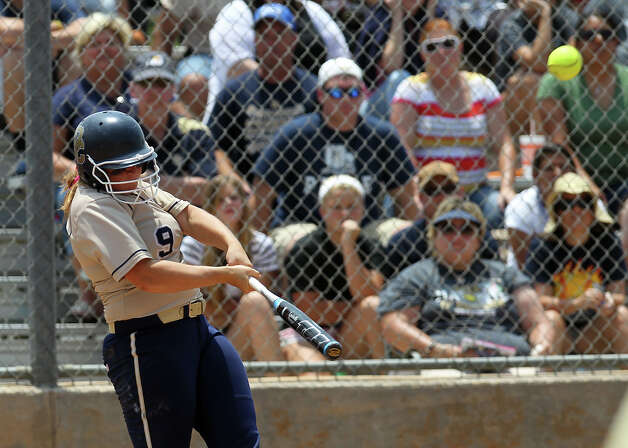 O'Connor's Maegan Taylor (09) smacks a two-run homer in the fifth inning against Judson in the second round of Class 5A softball playoffs on Saturday, May 5, 2012. O'Connor took the series by winning the first game on Friday and then again on Saturday with a 10-3 win over Judson. Photo: KIN MAN HUI, Kin Man Hui/Express-News / ©2012 San Antonio Express-News
