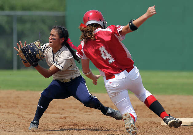 O'Connor's Brenda Ramirez (left) waits on the throw to attempt a tag at second on Judson's Nicole Shedd (04) in the second round of Class 5A softball playoffs on Saturday, May 5, 2012. Shedd had safely beaten the throw. However, O'Connor eventually took the best of three series by winning the first game on Friday and then again on Saturday with a 10-3 win over Judson. Photo: KIN MAN HUI, Kin Man Hui/Express-News / ©2012 San Antonio Express-News