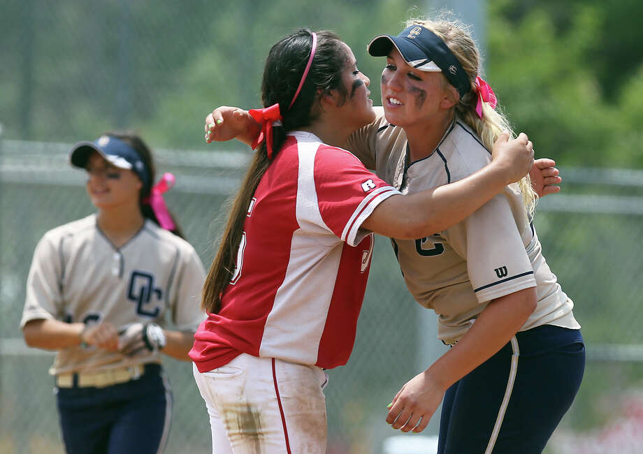 Judson's Stacy Perez (left) offers a congratulatory hug to O'Connor's Kenedy Urbany after O'Connor knocked off Judson in the second round of Class 5A softball playoffs, 10-3, on Saturday, May 5, 2012. O'Connor took the best of three series with wins on Friday and Saturday. Photo: KIN MAN HUI, Kin Man Hui/Express-News / ©2012 San Antonio Express-News