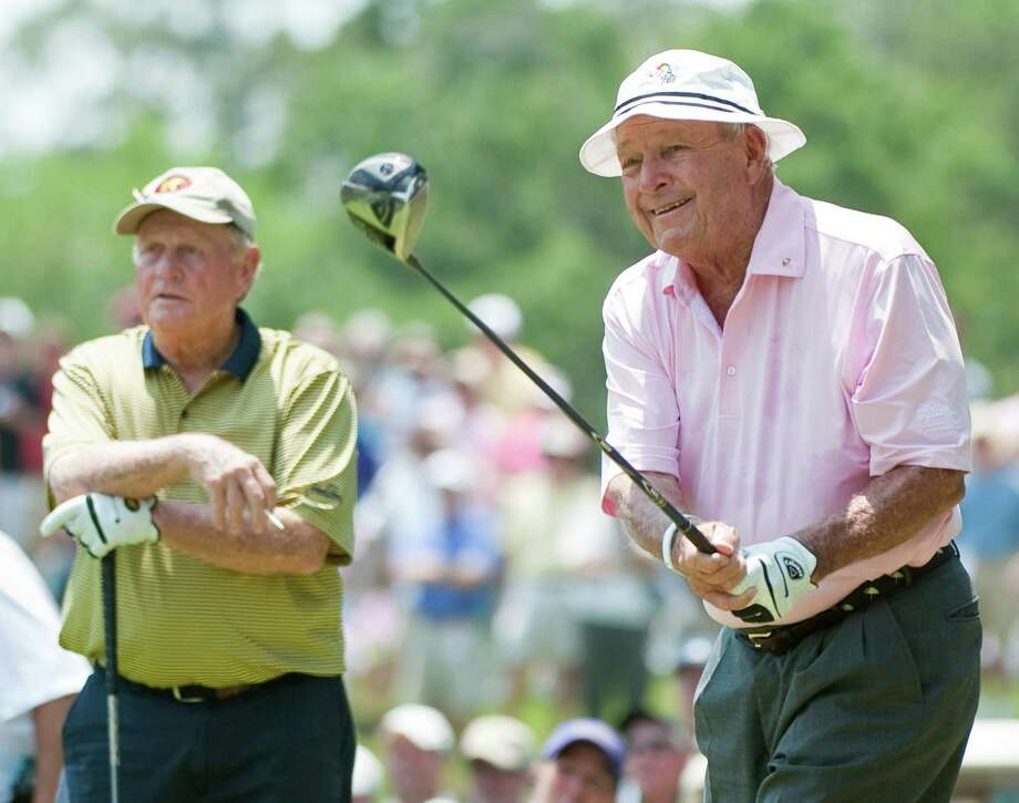 Arnold Palmer (right) played with fellow golfing legend Jack Nicklaus at an event in The Woodlands on Saturday. Photo: AP