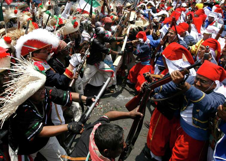 People Take Part In A Reenactment Of The Battle Of Puebla