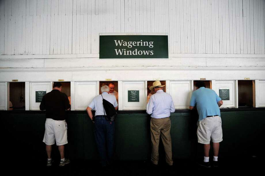 Derby goers place bets at the wagering windows during the 138th running of the Kentucky Derby at Churchill Downs on May 5, 2012 in Louisville, Kentucky. Photo: Michael Heiman, Getty Images / 2012 Getty Images