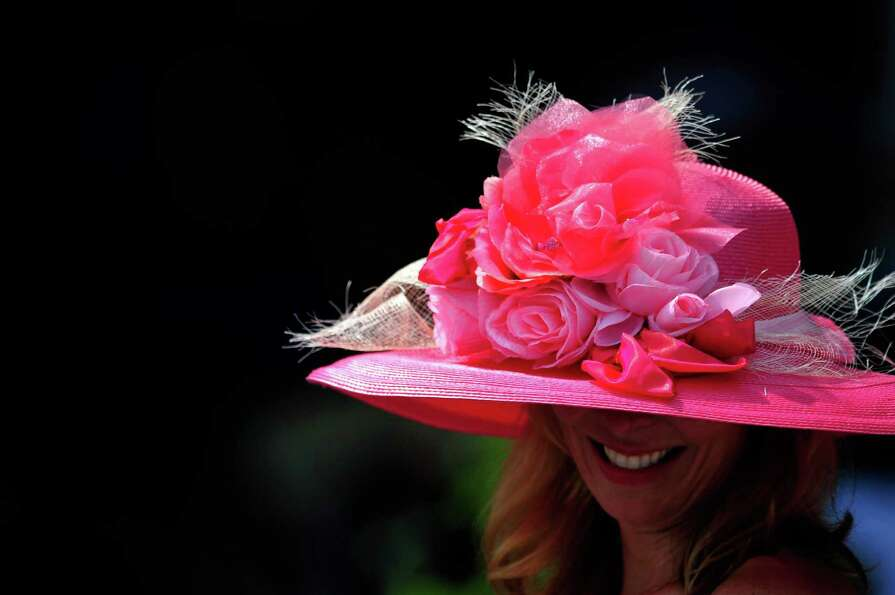 A horse racing fan wears a decorative hat prior to the 138th running of the Kentucky Derby at Church