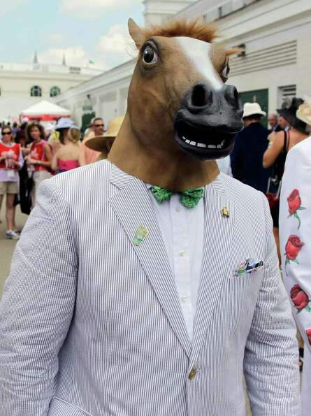 Gino Desimone arrives in a horse head mask for the 138th Kentucky Derby horse race at Churchill Down