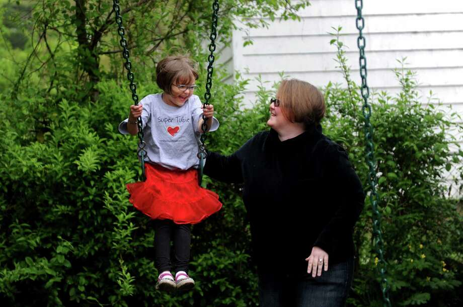 Christy Langguth pushes her five-year-old daughter, Diane, on the swing in the backyard of their Stratford home Thursday, May 3, 2012.  Diane needs a liver transplant and the Langguths are hopeful that the Facebook change, allowing members to share whether they are organ donors, will attract new potential donors. Photo: Autumn Driscoll / Connecticut Post