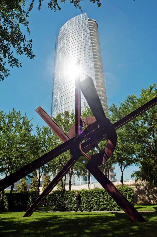 The glass skin of the Museum Tower reflects light onto the Nasher Sculpture Center in Dallas. Photo: BRANDON THIBODEAUX / NYTNS