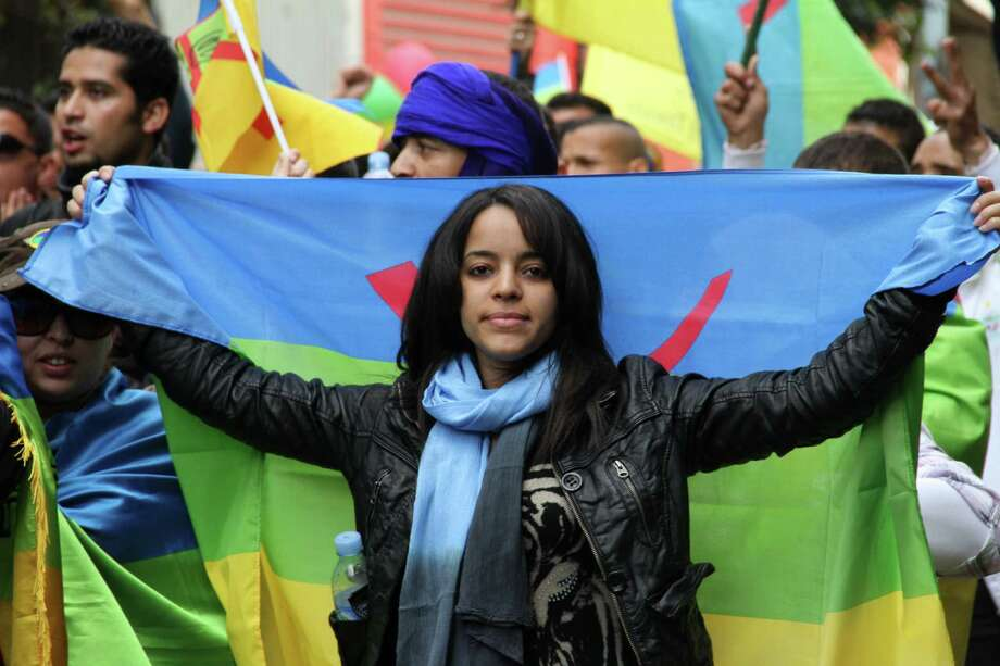 An activist carries the Berber flag in April during a march calling for more autonomy in the Moroccan city of Casablanca. North Africa's original inhabitants seek rights separate from Arab-dominated Islamist rule. Photo: Paul Schemm / AP