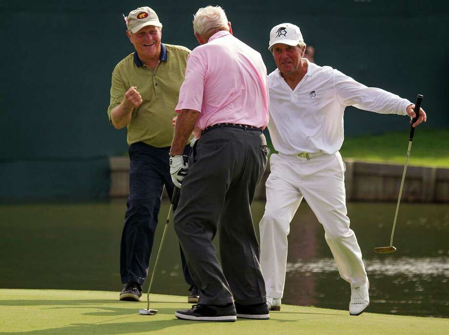 Jack Nicklaus, Arnold Palmer and Gary Player celebrate their victory after Palmer sunk a put on the 18th hole during The Insperity Championship Greats of Golf exhibition at The Woodlands Country Club on Saturday, May 5, 2012, in The Woodlands. Photo: Smiley N. Pool, Houston Chronicle / © 2012  Smiley N. Pool