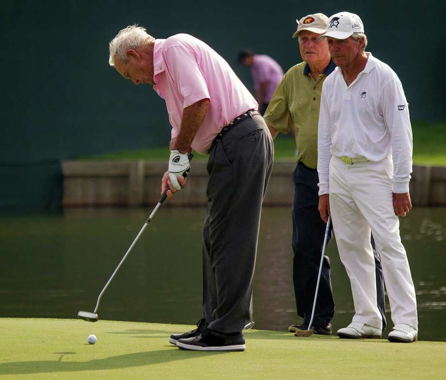 Arnold Palmer sinks a putt on the 18th hole as Jack Nicklaus and Gary Player look on during The Insperity Championship Greats of Golf exhibition at The Woodlands Country Club on Saturday, May 5, 2012, in The Woodlands. Photo: Smiley N. Pool, Houston Chronicle / © 2012  Smiley N. Pool