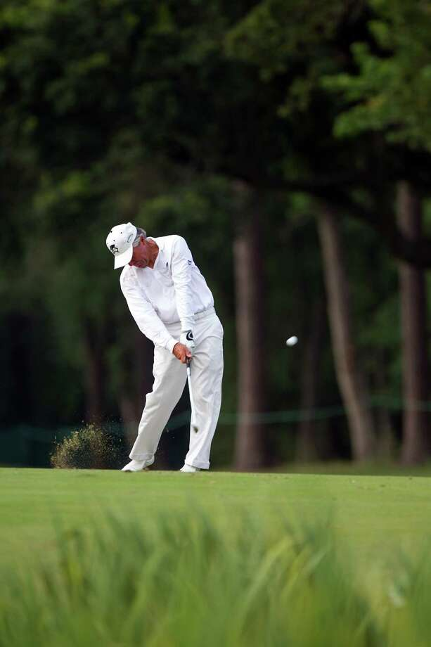Gary Player hits a shot on the 17th fairway during The Insperity Championship Greats of Golf exhibition at The Woodlands Country Club on Saturday, May 5, 2012, in The Woodlands. Photo: Smiley N. Pool, Houston Chronicle / © 2012  Smiley N. Pool
