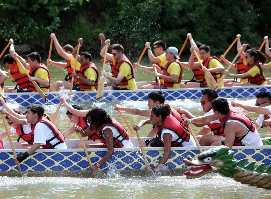 Teams paddle fast in the qualifying heat during the 12th Annual Houston Dragon Boat Festival at Allen's Landing on Saturday, May 5, 2012, in Houston.  The Texas Dragon Boat Association, in collaboration with Buffalo Bayou Partnership, hosted approximately 32  race teams. Photo: Mayra Beltran, Houston Chronicle / © 2012 Houston Chronicle