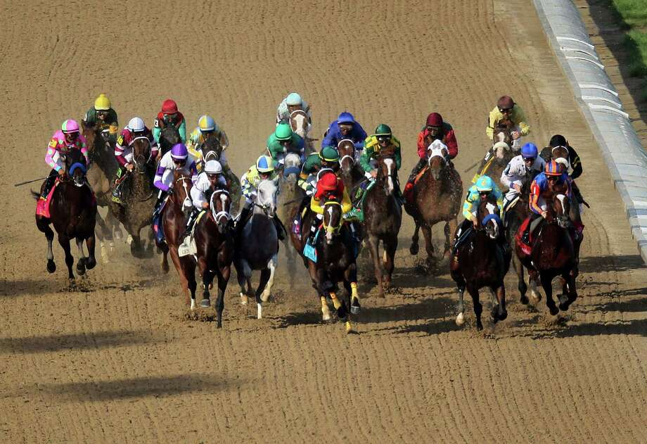 LOUISVILLE, KY - MAY 05:  The field of horses races down the frontstretch