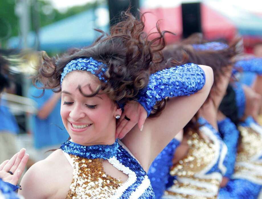 Emily Gutierrez, 17, performs with Milby High School Charlie's Angles Dance Team during the East End Street Festival. Photo: Mayra Beltran, Houston Chronicle / © 2012 Houston Chronicle