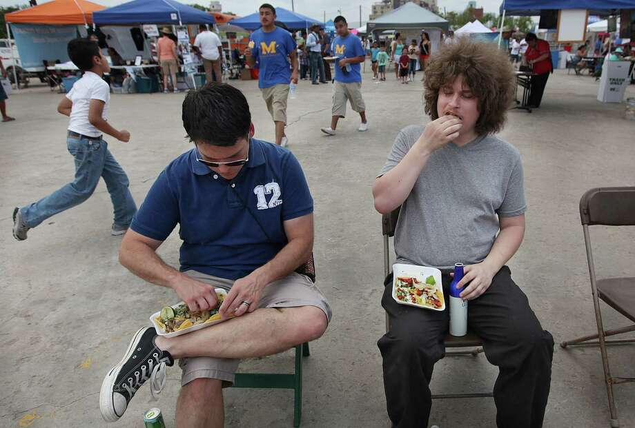 "Joel Brotzman and Tim Chalt eat tacos from Monterey Taqueria as a handful of vendors battle for ""The Best Taco Truck"". Photo: Mayra Beltran, Houston Chronicle / © 2012 Houston Chronicle"