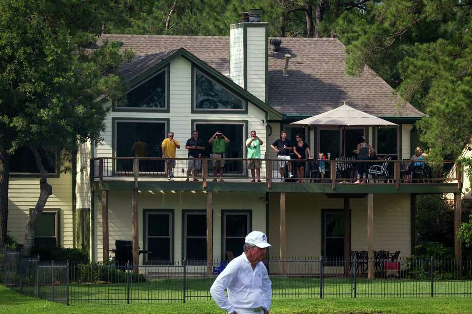 Fans watch from a balcony as Gary Player lines up a putt during The Insperity Championship Greats of Golf exhibition at The Woodlands Country Club on Saturday, May 5, 2012, in The Woodlands. Photo: Smiley N. Pool, Houston Chronicle / © 2012  Smiley N. Pool