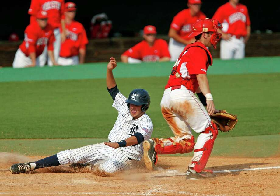 May 5: Rice 4, UH 3 (10 innings) Rice University's Christian Stringer slides into home plate to score the winning run against the University of Houston during the tenth inning of college baseball game action at Reckling Park Saturday, May 5, 2012, in Houston. Photo: James Nielsen, Chronicle / © Houston Chronicle 2012