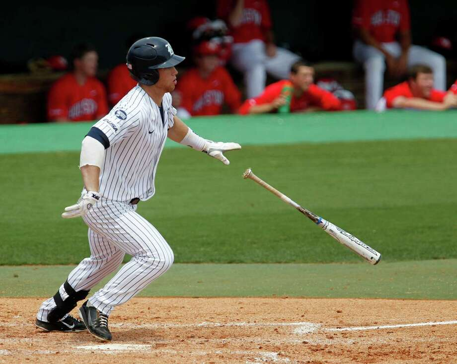 Rice University's Michael Ratterree drops the bat after hitting the ball for a base hit against the University of Houston's during the fourth inning of college baseball game action at Reckling Park Saturday, May 5, 2012, in Houston. Photo: James Nielsen, Chronicle / © Houston Chronicle 2012