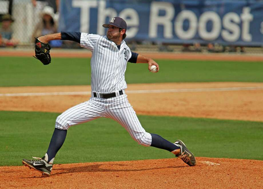 Rice University's Taylor Wall throws a pitch against the University of Houston during the fourth inning of college baseball game action at Reckling Park Saturday, May 5, 2012, in Houston. Photo: James Nielsen, Chronicle / © Houston Chronicle 2012