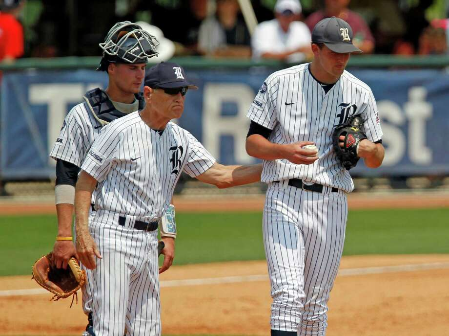 Rice University's head coach Wayne Graham 2nd from left pulls starting pitcher Austin Kubitza from the game during the fourth inning of college baseball game against the University of Houston at Reckling Park Saturday, May 5, 2012, in Houston. Photo: James Nielsen, Chronicle / © Houston Chronicle 2012