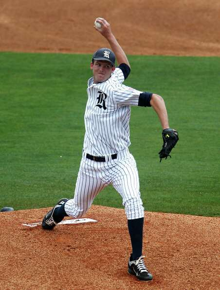 Rice University's Austin Kubitza throws a pitch against the University of Houston during the first i