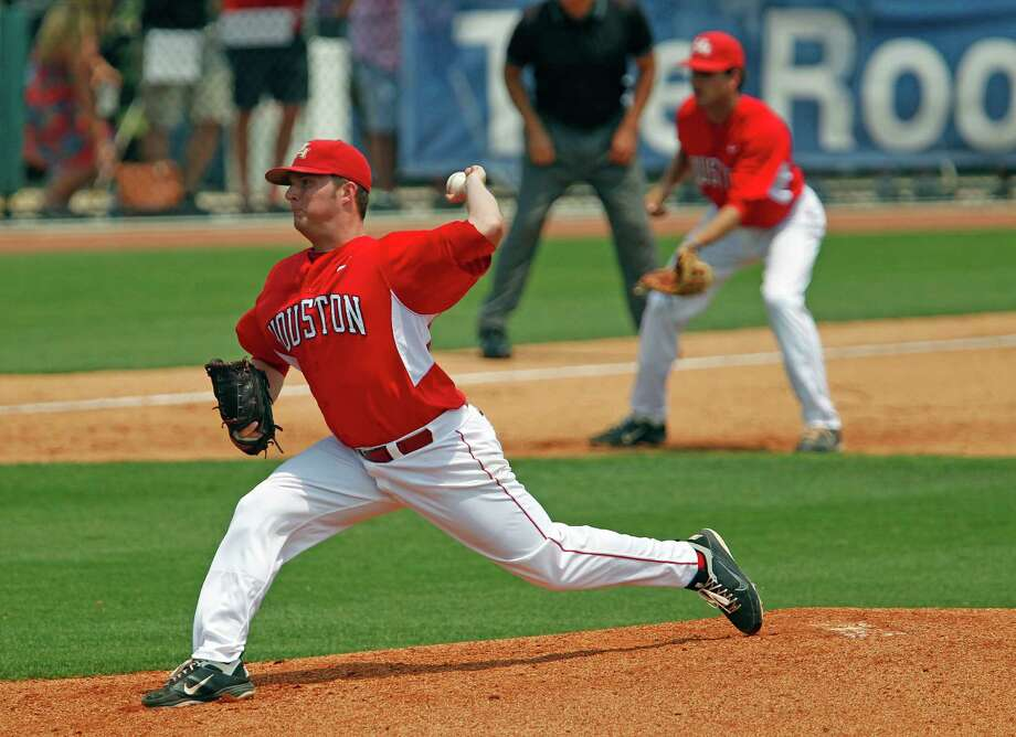 The University of Houston's Jordan Lewis throws a pitch against Rice University during the third inning of college baseball game action at Reckling Park Saturday, May 5, 2012, in Houston. Photo: James Nielsen, Chronicle / © Houston Chronicle 2012