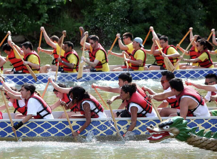 Teams paddle fast in the qualifying heat during the 12th Annual Houston Dragon Boat Festival at Allen's Landing on Saturday, May 5, 2012, in Houston. Photo: Mayra Beltran, Houston Chronicle / © 2012 Houston Chronicle
