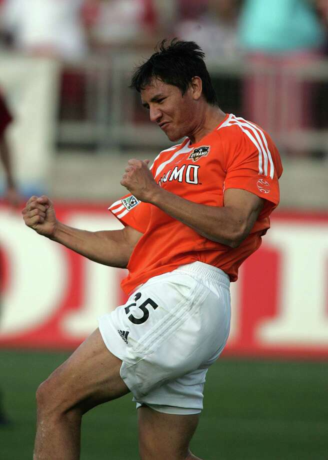 The Houston Dynamo's Brian Ching celebrates after scoring the franchise first goal against the Colorado Rapids during the first half of Sunday's MLS season opening game at the University of Houston's Robertson Stadium April 2,2006 in Houston, Texas.  James Nielsen (For the Houston Chronicle) Photo: James Nielsen / Freelance