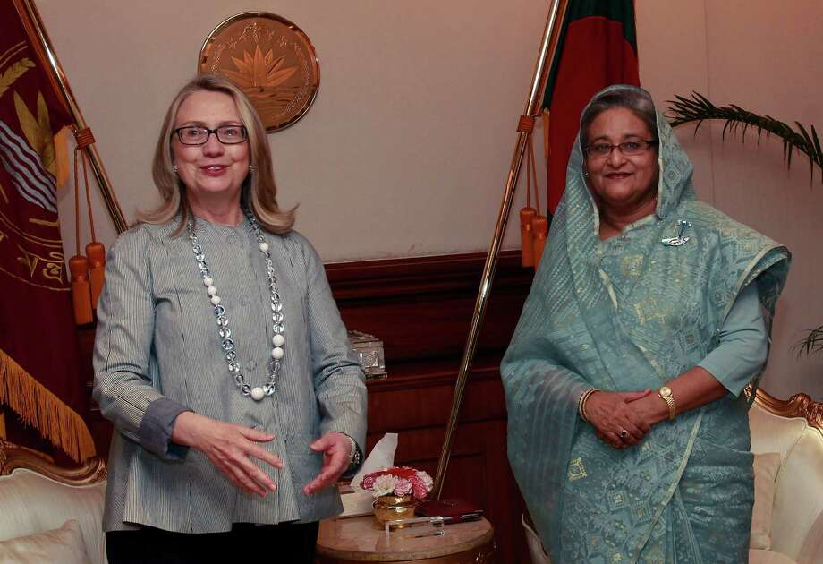 Secretary of State Hillary Rodham Clinton met in Dhaka, Bangladesh, with Prime Minister Sheikh Hasina on Saturday, urging political reconciliation. Photo: SHANNON STAPLETON / Pool Reuters