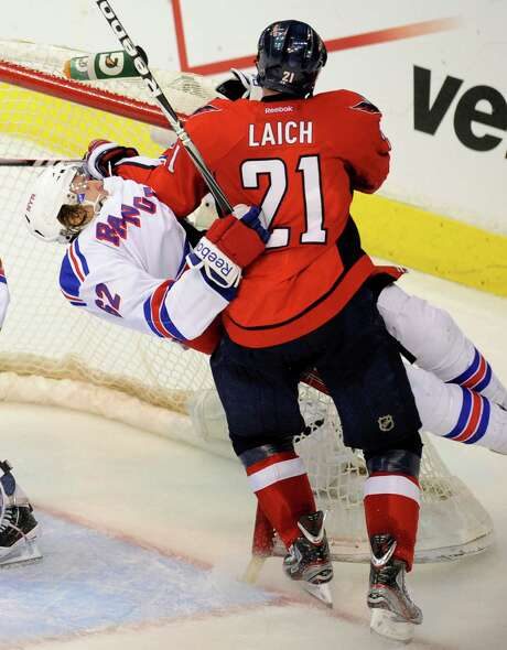 Brooks Laich (right) and the Capitals hit back after a triple-overtime loss to tie the series with a Game 4 victory. Photo: AP