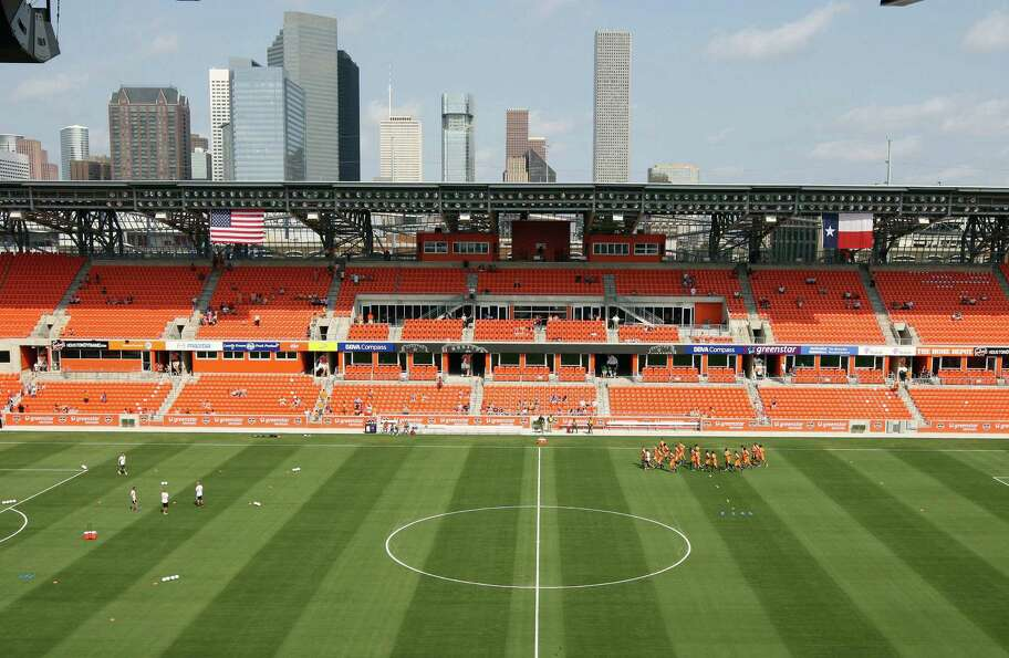 Fans watch as the Houston Dynamo soccer team practices at BBVA Compass Stadium Saturday, May 5, 2012