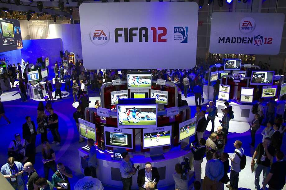 """Attendees visit the Electronic Arts Inc. booth at the Electronic Entertainment Expo (E3) in Los Angeles, California, U.S., on Wednesday, June 8, 2011. Electronic Arts Inc. previewed """"Need for Speed: The Run,"""" a racing game similar to Take-Two Interactive Software Inc.'s """"Grand Theft Auto"""" series. Photographer: Jonathan Alcorn/Bloomberg Attendees visit the Electronic Arts Inc. booth at the Electronic Entertainment Expo (E3) in Los Angeles, California, U.S., on Wednesday, June 8, 2011. Electronic Arts Inc. previewed """"Need for Speed: The Run,"""" a racing game similar to Take-Two Interactive Software Inc.'s """"Grand Theft Auto"""" series. Photographer: Jonathan Alcorn/Bloomberg Photo: Jonathan Alcorn, Bloomberg"""