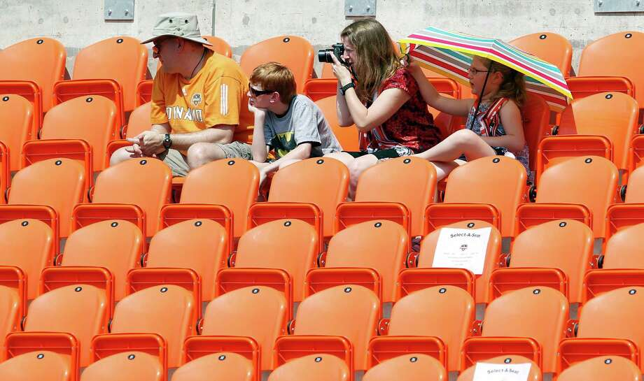 Dean Campa left, his ten-year-old son Alec Campa, his wife Samantha Campa and seven-year-old daughter Mabyn Campa during the Houston Dynamo soccer team practice at BBVA Compass Stadium Saturday, May 5, 2012, in Houston. Photo: James Nielsen, Chronicle / © Houston Chronicle 2012