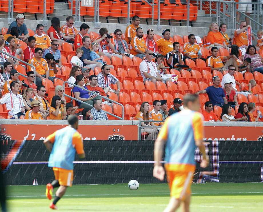 Fans watch as the Houston Dynamo soccer team practices at BBVA Compass Stadium Saturday, May 5, 2012, in Houston. Photo: James Nielsen, Chronicle / © Houston Chronicle 2012