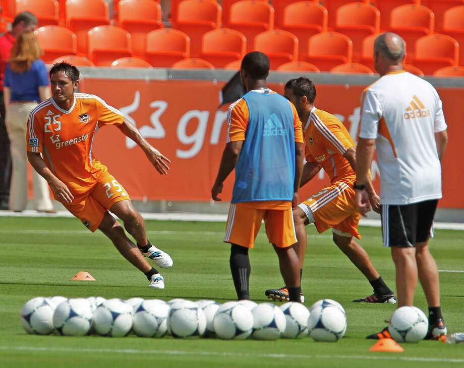 The Houston Dynamo's Brian Ching left, during the Houston Dynamo soccer team practice at BBVA Compass Stadium Saturday, May 5, 2012, in Houston. Photo: James Nielsen, Chronicle / © Houston Chronicle 2012