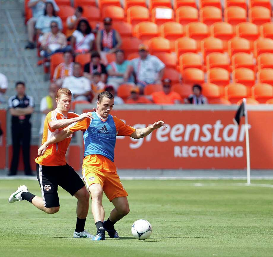 The Houston Dynamo's Andre Hainault left, and Warren Creavalle during the Houston Dynamo soccer team practice at BBVA Compass Stadium Saturday, May 5, 2012, in Houston. Photo: James Nielsen, Chronicle / © Houston Chronicle 2012