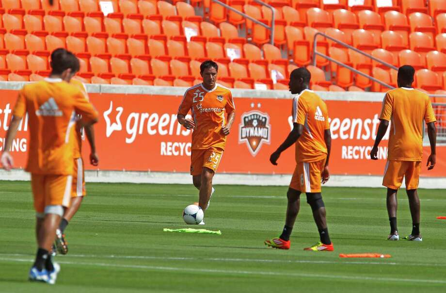 The Houston Dynamo's Brian Ching center, during the Houston Dynamo soccer team practice at BBVA Compass Stadium Saturday, May 5, 2012, in Houston. Photo: James Nielsen, Chronicle / © Houston Chronicle 2012