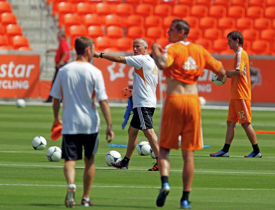 Houston Dynamo head coach Dominic Kinnear center, during the Houston Dynamo soccer team practice at BBVA Compass Stadium Saturday, May 5, 2012, in Houston. Photo: James Nielsen, Chronicle / © Houston Chronicle 2012