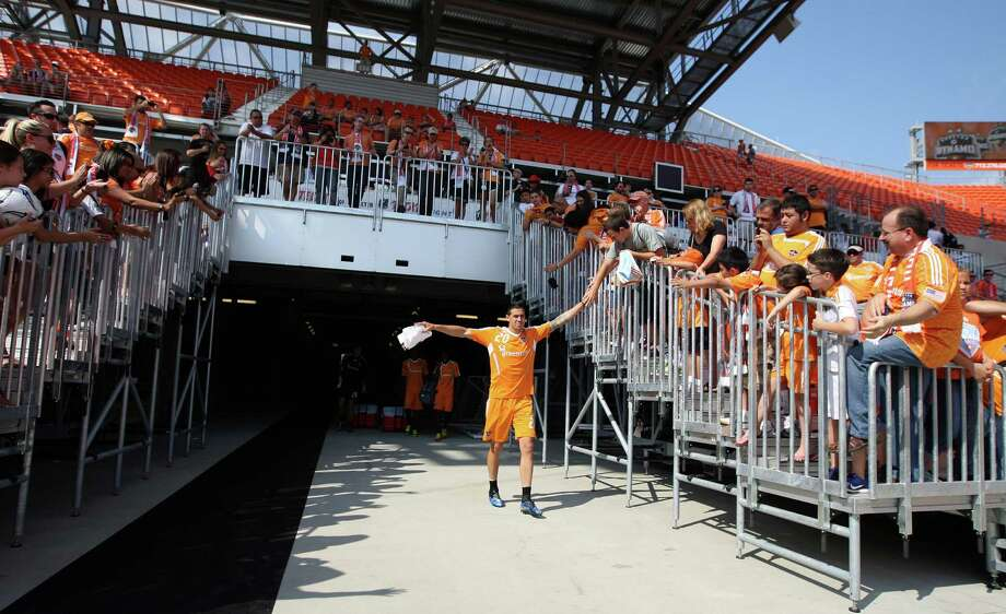 The Houston Dynamo's Geoff Cameron walks on to the field before the Houston Dynamo soccer team practice at BBVA Compass Stadium Saturday, May 5, 2012, in Houston. Photo: James Nielsen, Chronicle / © Houston Chronicle 2012