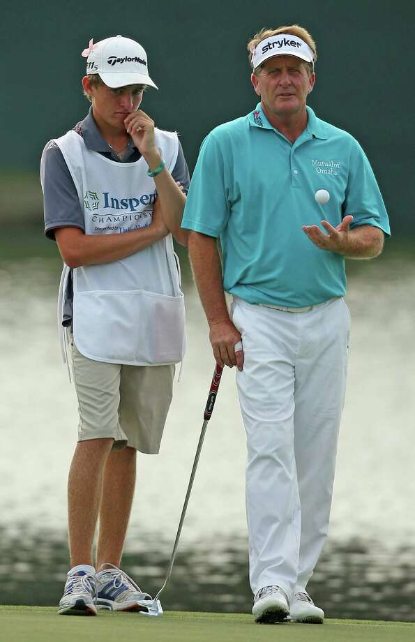 Fred Funk and son/caddie Taylor wait for Funk's turn to putt on No. 18 during the second round of the Insperity Championship, Saturday, May 5, 2012 at the Tournament Course in The Woodlands, TX. Funk birdied the hole to tie Tom Lehman for first place at 9-under par. Photo: Eric Christian Smith, For The Chronicle