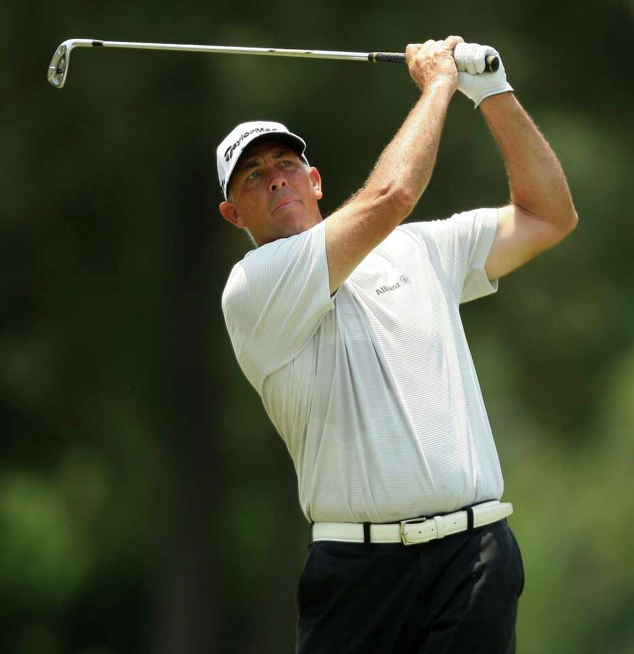 Tom Lehman follows his approach shot on No 5. during the second round of the Insperity Championship, Saturday, May 5, 2012 at the Tournament Course in The Woodlands, TX. Photo: Eric Christian Smith, For The Chronicle