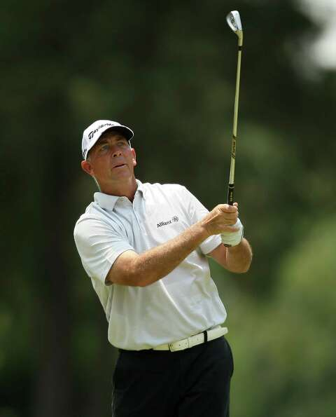Tom Lehman follows his approach shot on No 5. during the second round of the Insperity Championship,