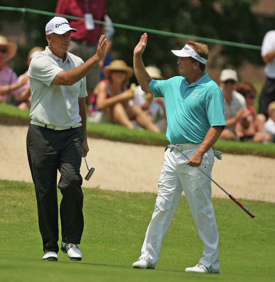 Tom Lehman (left) gets a high five from playing partner Fred Funk after making birdie on No. 3 during the second round of the Insperity Championship, Saturday, May 5, 2012 at the Tournament Course in The Woodlands, TX. Photo: Eric Christian Smith, For The Chronicle
