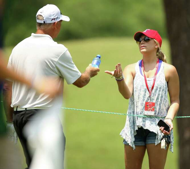 Tom Lehman hands daughter Rachael a bottle of water on the No. 5 fairway during the second round of