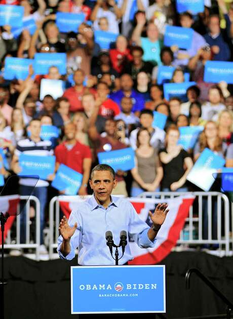 """President Barack Obama told some 14,000 supporters Saturday in Columbus, Ohio, that the 2012 election """"is a make-or-break moment for the middle class."""" Photo: Mark Duncan / AP"""