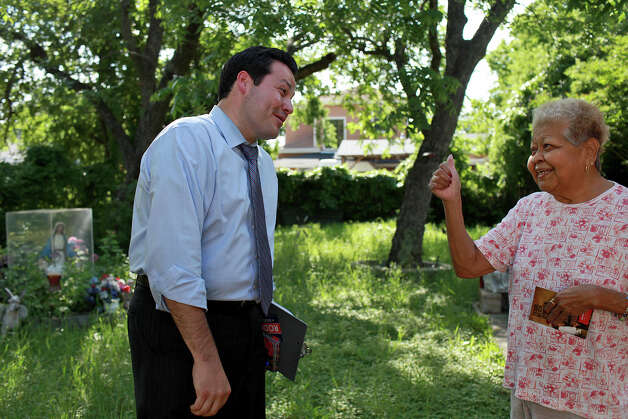 Former City Councilman Justin Rodriguez gets a thumbs-up from voter Mary Santellan  as he campaigns last month. Rodriguez's record makes him the best candidate in the Democratic primary. Photo: Lisa Krantz, San Antonio Express-News / SAN ANTONIO EXPRESS-NEWS