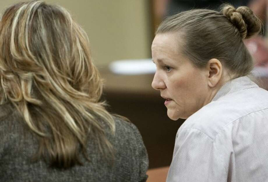 Shorten, right, talks to her attorney, Scharlene Overstreet during a hearing in Conroe. (Cody Duty / Associated Press)