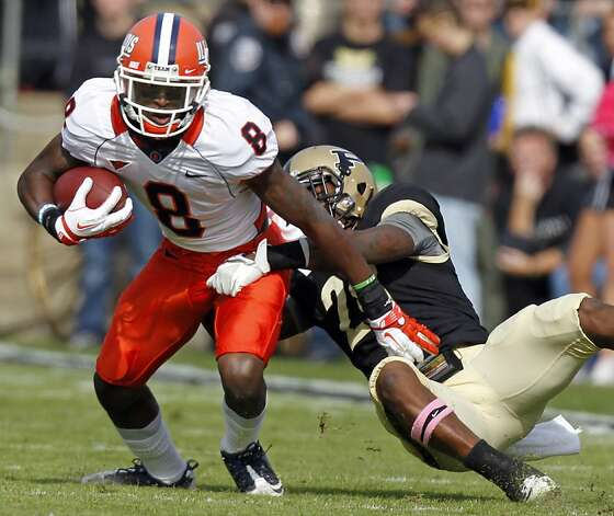 Illinois receiver A.J. Jenkins, left, is tackled by Purdue cornerback Josh Johnson during the first half of an NCAA college football game in West Lafayette, Ind., Saturday, Oct. 22, 2011. (AP Photo/Michael Conroy) Photo: Michael Conroy, ASSOCIATED PRESS