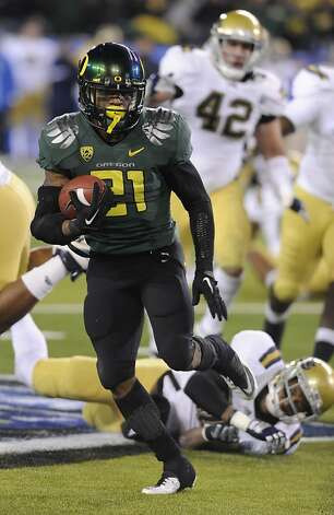 Oregon's LaMichael James (21) runs against UCLA in the first half of the NCAA Pac-12 Championship college football game in Eugene, Ore., Saturday, Dec 2, 2011. (AP Photo/Greg Wahl-Stephens) Photo: Greg Wahl-stephens, Associated Press