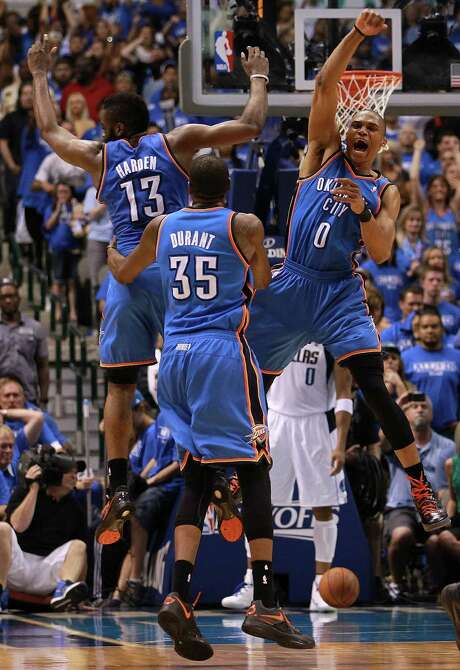 Oklahoma City's James Harden, Kevin Durant and Russell Westbrook bask in the closing moments of their series-clinching win over Dallas. Photo: Ronald Martinez, Getty Images / 2012 Getty Images